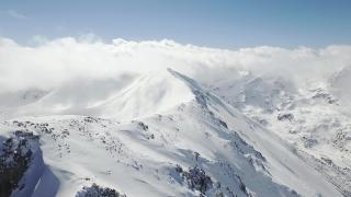 Beautiful Winter Aerial Flight Over Mountain Chain Landscape Swiss Alps Adventure Hiking Trekking Ski Vacation Travel Concept UHD 4K