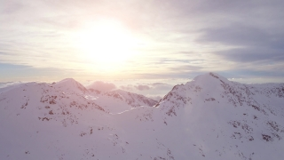 Aerial Flight Toward Beautiful Sunrise Over Mountains Passing Through Clouds Beautiful Winter Nature Landscape Background  UHD 4K