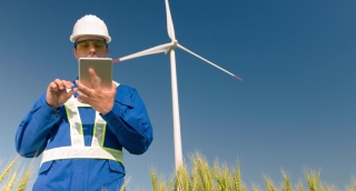 Agriculture Supervisor Using Digital Tablet Windmill Technology Protective Uniform Renewable Energy Windpower Sustainability Engineering Development