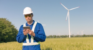 Supervisor Using Digital Tablet Agricultural Landscape Windmill Technology Protective Uniform Renewable Energy Windpower Sustainability Engineering Development