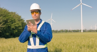 Supervisor Using Digital Tablet Agricultural Landscape Windmill Technology Renewable Energy Windpower Sustainability Engineering Development Protective Uniform