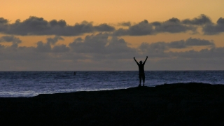 Beach Silhouette Man Standing Arms Outstretched Water Nature Sea Sunset Sky Travel Vacation Footage Enjoyment Freedom Island Tourism Hawaii 4K