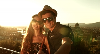 Attractive Young Couple on vacation Europe Taking Selfie Happy Technology