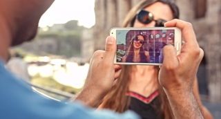 Man Taking Picture of Beautiful Young Woman Italy Vacation Smartphone
