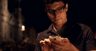Successful Young Business Man Using Smartphone on Vacation
