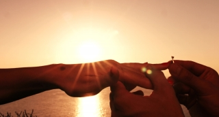 Marriage Proposal Putting Ring On Hand Finger At Sunset Close Up Romantic Wedding Concept Holding Hands Bride Groom Uhd 4K