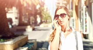 Beautiful Young Female Businesswoman Talking On Cellphone Smartphone 4G Connection Wi-Fi Summer Day Urban Setting 4K Uhd