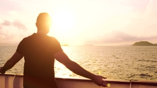 Young Man Spiritual Worship Pose Outstretched  Arms Sun Cruise Ship Water Sunset Flare Ocean Island Freedom Rescue Faith Party Prayer Vacation Happiness Travel Uhd 4K