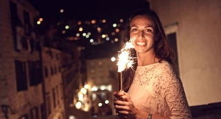 Pretty Woman Dancing Happy Joyful Travel Holding Flare Sparkler Fire Smiling Face Celebration Celebrating Vacation Holiday Christmas New Years Eve Concept Uhd 4K