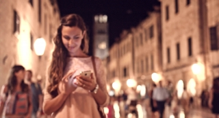Pretty Young Professional Woman Typing Touchscreen Smartphone Travel App Texting Sms Message Vacation Romantic Destination Holiday Happiness Night Beauty Uhd 4K