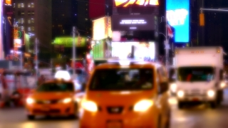 New York City Street Illuminated Manhattan Night USA Footage Busy Traffic Crowded Transportation Connection Truck Taxi Road Buildings