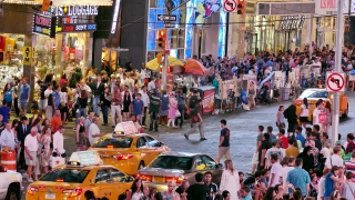 NEW YORK, USA - CIRCA JULY 2016: New York City street crowd in Manhattan Times Square. People walk as cars and taxis pass by.