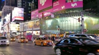 NEW YORK, USA - CIRCA JULY 2016: New York City traffic on Times Square passes through crowded street.