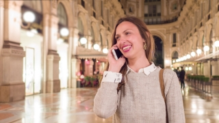 Beautiful Young Woman Talking On The Phone Traveling On Vacation In Europe Happy Smiling Shopping Holiday
