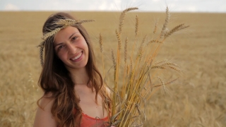 Healthy Lifestyle Woman Holding Organic Wheat Field Concept