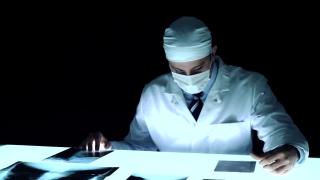 Physician Dark Room Laboratory Looking Examining x rays
