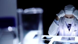 Medical Laboratory Surgeon Examining Data