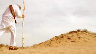 Middle Eastern Man Walking in Desert HD