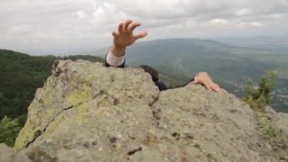 Young Businessman Hanging Danger Climbing Up Success