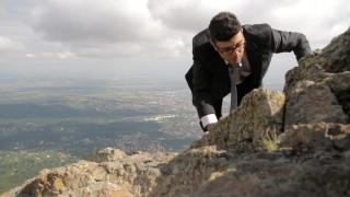Business Climb to Success Tired Businessman Metaphor