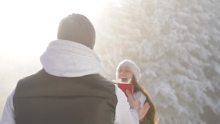 Cute Young Couple Christmas Outdoors Present Joy Hugging