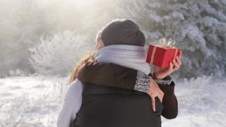 Pretty Young Woman Hugging Boyfriend Christmas Present Winter