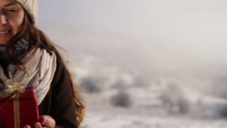 Young Woman Reaching Present Outdoors Winter Joy Beauty