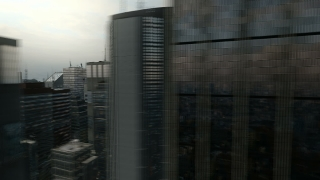 Fast Aerial Flight Around 3D City Skyline Business Background Seamless Loop HD