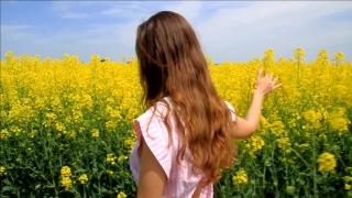 Young Woman in Vintage Dress Walking Yellow Field Flowers