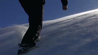 Man Walking Up a Mountain Winter Nature Background HD