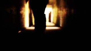 Man Suit Running Toward Shining Light Salvation Freedom Concept