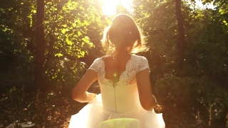 Woman In Vintage Wedding Dress Running Slow Motion Forest