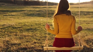 Lonely Depressed Vintage Young Woman on Swing