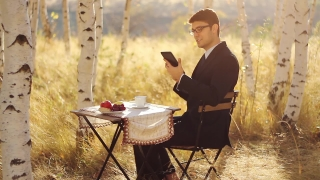 Handsome Young Businessman Reading tablet