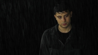 Young Man Standing Wet in Rain Depression Sadness