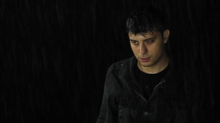 Young Man in Rain Wet Depressed Desperate Alone