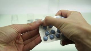 Taking tablests medication overdose concept