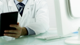 Doctor Pointing Tablet Female Nurse Smiling Medical Technology