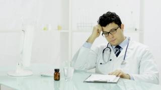 Doctor Uneasy Sad Signing Diagnosis Prescription Medical Guilt