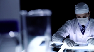 Physician examining x-ray bad news concept dark room