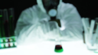 Biohazard Gas Mask Chemist Mixing Radioactive Liquid