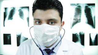 Doctor Examining Camera Delivering Bad News Concept