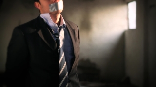 Businessman Hostage Tape over Mouth Tied Up Scared