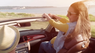 Excited Young Man  And Woman High Fiving Driving A Convertible By The Beach Honeymoon Love Romantic Couple On Vacation Concept