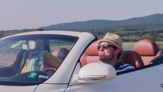 Happy Couple Arrive At Beach In A Convertible And Jump Out To Enjoy The Summer Slow Motion Sun On Vacation Ocean Front Sand