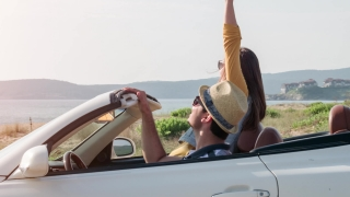 Happy Man And Woman Arrive At Beach In Convertible Car Happy Holiday Vacation Day Off Beautiful Seaside Travel Concept