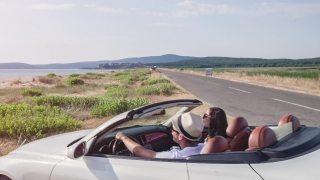 Young Couple Arrive At Beach In Convertible Happy Kiss Joyful Vacation New Beginning Travel Relaxation Sunshine Sunset Holiday
