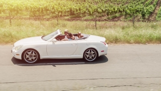 Convertible Car Driving Through Beautiful Countryside Road By Vineyard Tuscany Travel Aerial Shot Sunset Vacation Lifestyle