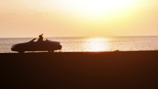 Silhouette Of A Happy Couple Driving Cabriolet Convertible By The Seaside Sunset Travel Destination Tourism Concept