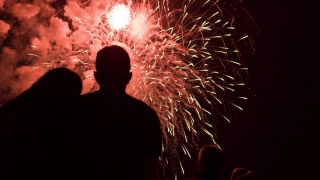 New Years Eve Fireworks Display As Couple Silhouette Hugging Young Love Romantic Date Celebration Concept